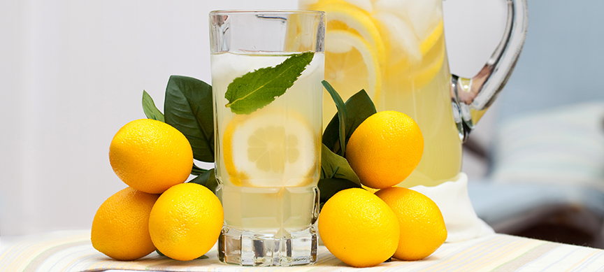 Drinking-lemon-water-Pitcher-and-glass-of-lemon-water.