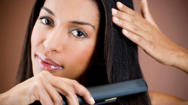 062915-centric-beauty-style-woman-straightening-hair
